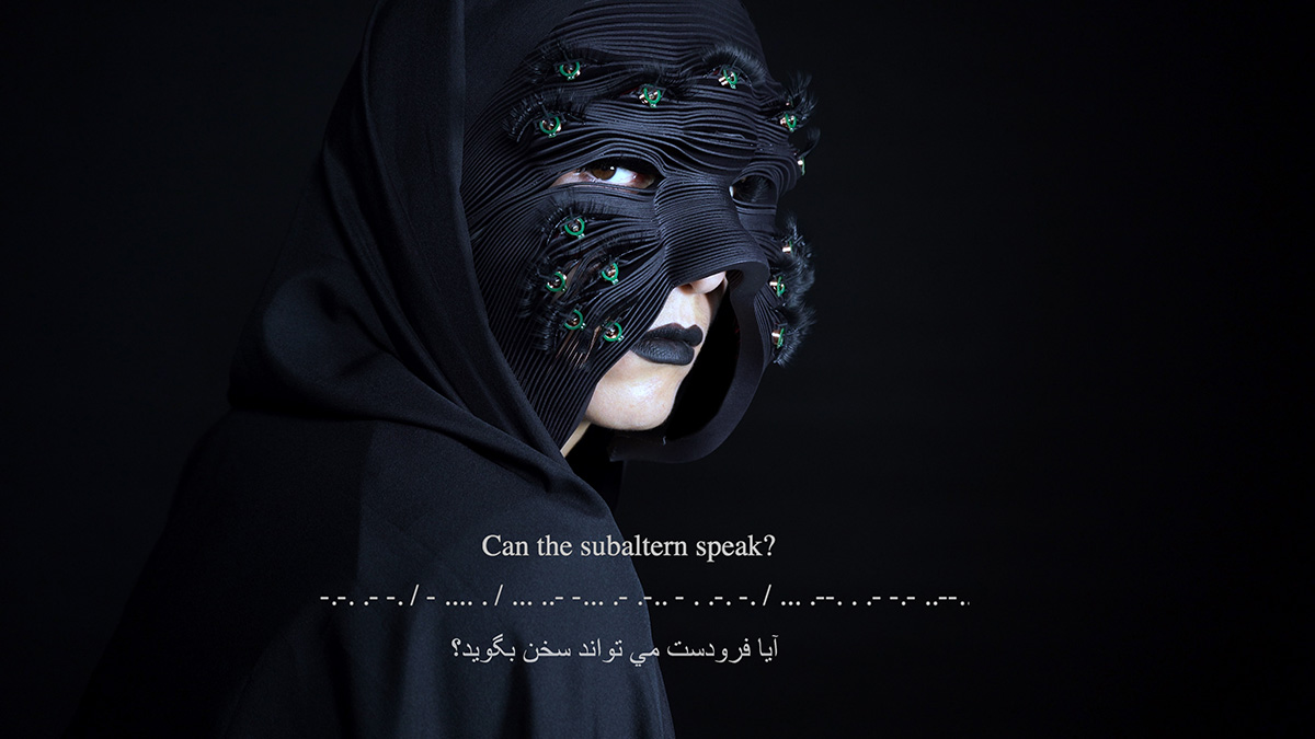 "Woman looks at the camera while wearing a black, layered mask. Words on the image: ""Can the subaltern speak?"""